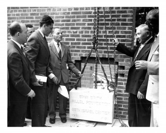 Laying the cornerstone, 1429 Hill Street, 1951. Herb Schlager (left), Rabbi Herschel Lyman (tall man), Osias Zwerdling (holding the rope), Tom Cook (holding the chain).