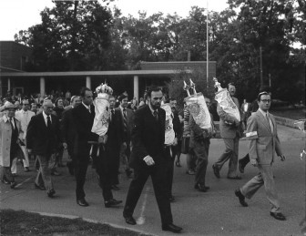 Marching the Torahs from the 1429 Hill building to the new synagogue at 2000 Washtenaw. Rabbi Alan Kensky on the left, Henry Gershowitz on the right. Erev Rosh HaShanah 1978.