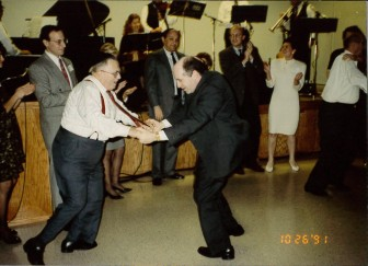 Henry Gershowitz and Rabbi Dobrusin dancing at the 75th anniversary celebration, 10/26/91